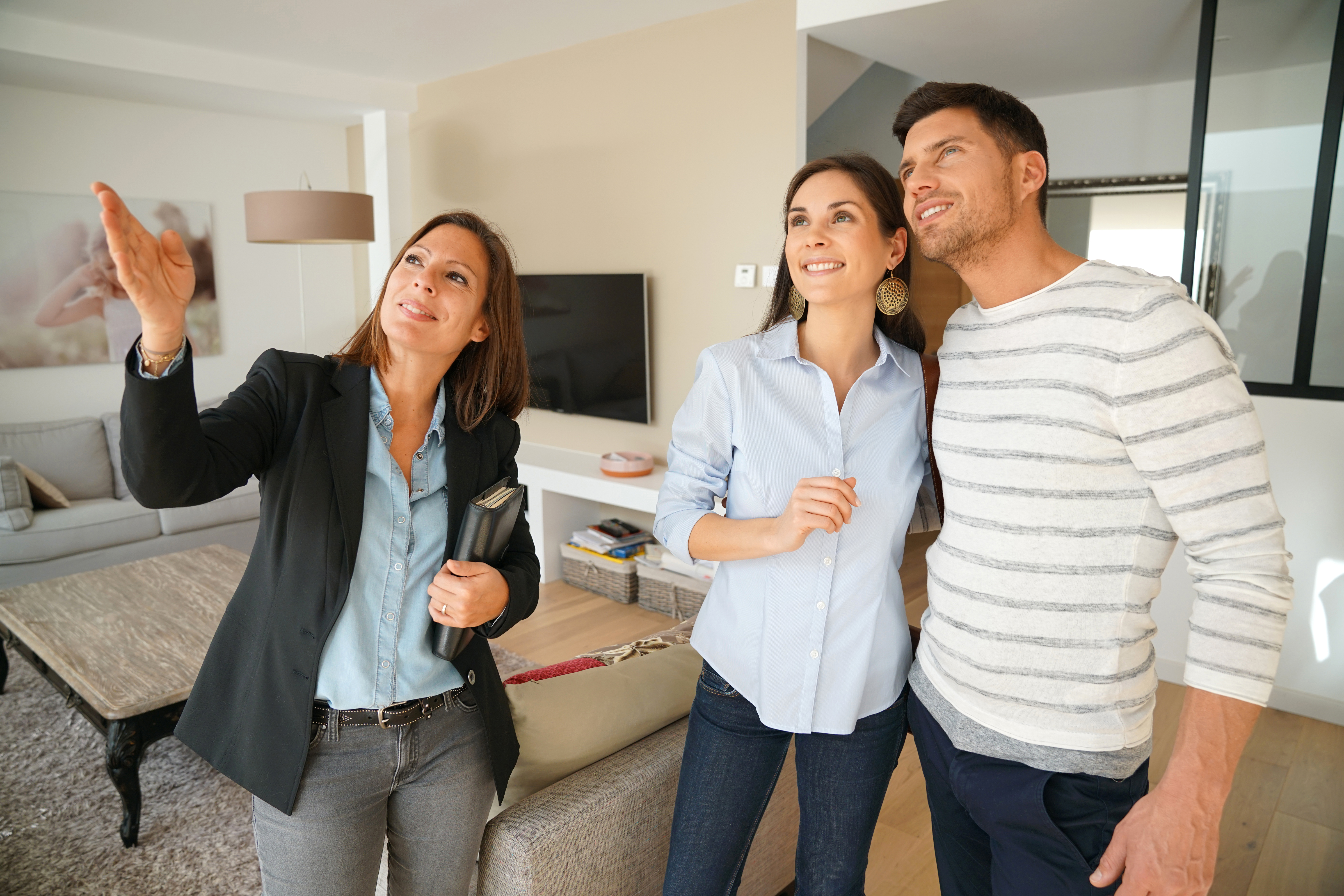 Real estate agent showing home to couple