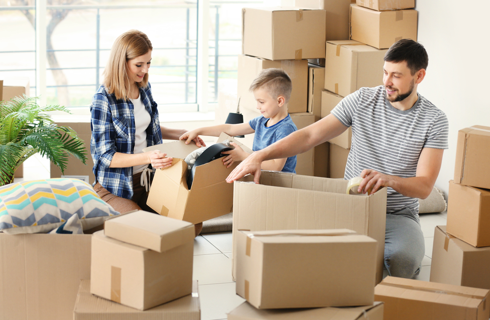 A young family unpacking their boxes after moving