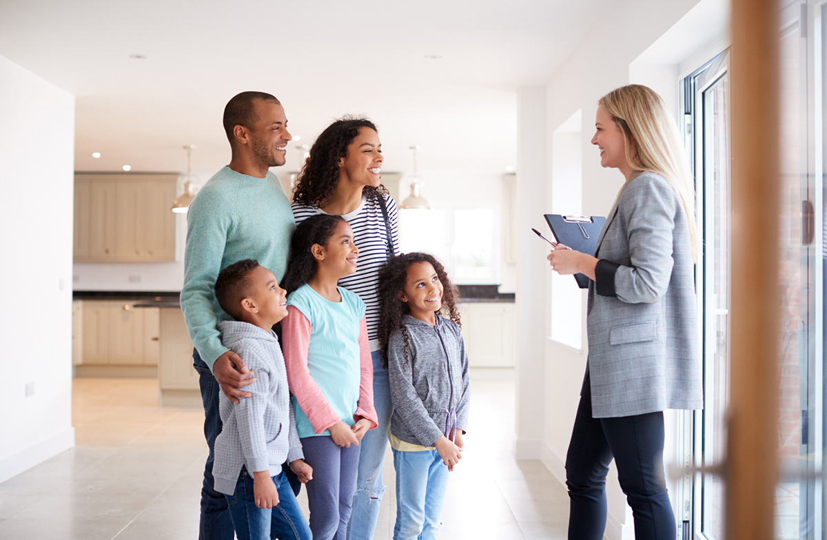 Realtor and family touring home