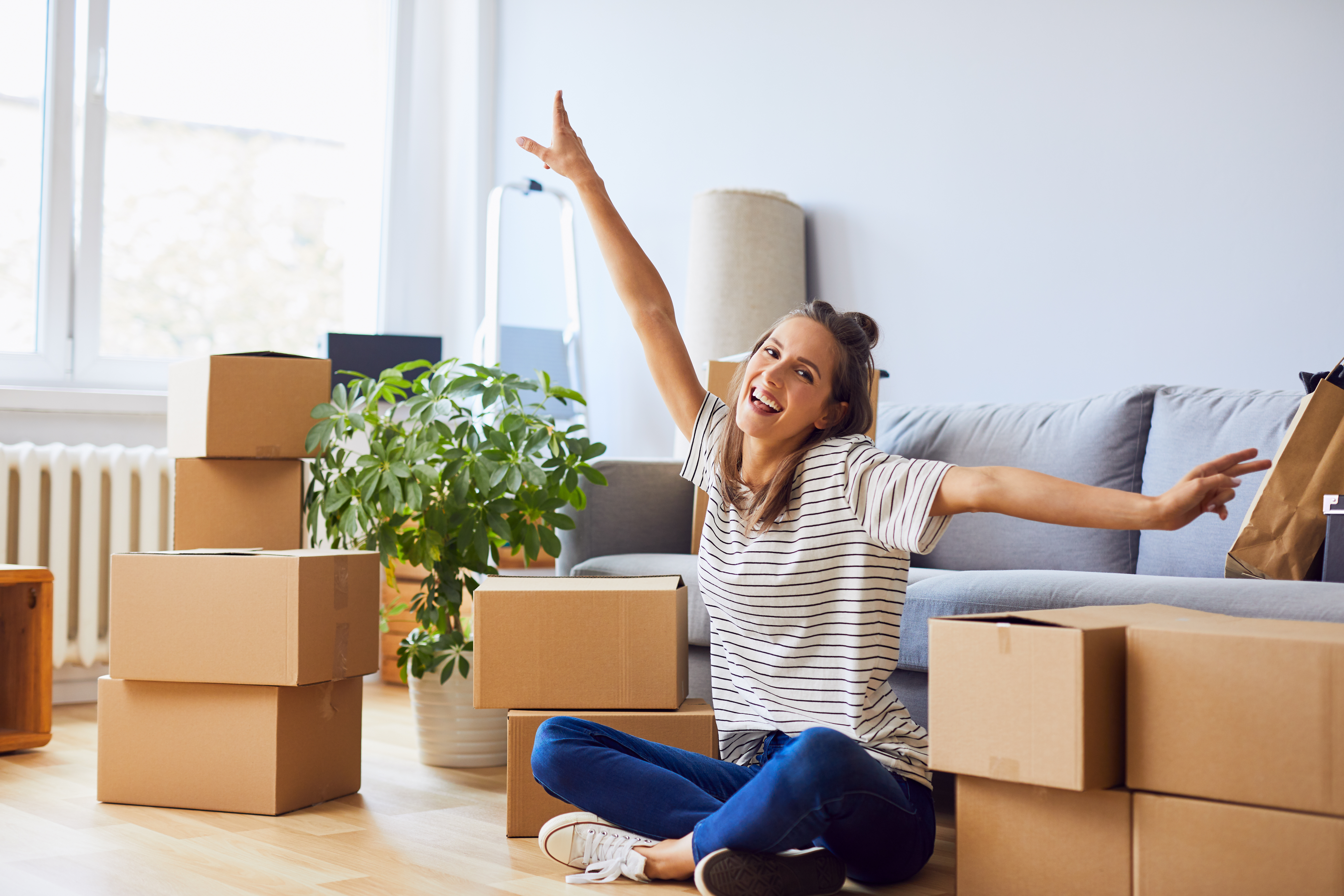 Young woman unpacking boxes
